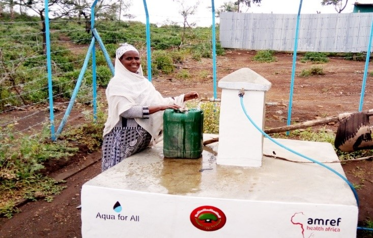 Belaynesh fetching water at a water point constructed by MWEB project in the outskirt of Adama town